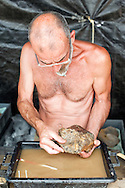 Dominique ('Doumé') Augier, from the Museum of Angoulême, cleaning finds at the palaeontological excavations at Angeac, Charente, France (July 2016) © Rudolf Abraham