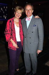 NEIL & CHRISTINE HAMILTON at a party to celebrate a new collection of sexy underware by Janet Reger called 'Naughty Janet' held at 5 Cavendish Square, London on 19th October 2004.<br />