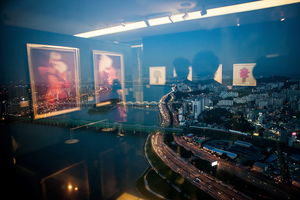 "Reflections of an exhibition with Asian Art Work on the top floor of the ""The 63 Building"", officially the 63 City, at a skyscraper on Yeouido island, overlooking the Han River in Seoul, South Korea."