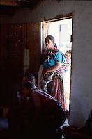 Woman in a doorway, Santa Clara, Guatemala