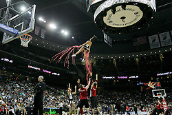Apr 11; Newark, NJ, USA; a New Jersey Nets cheerleader flies in the air during the second half at the Prudential Center. The Bobcats defeated the Nets 105-103.