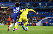 Willian takes on Avi Rikan during the Champions League match between Chelsea and Maccabi Tel Aviv at Stamford Bridge, London, England on 16 September 2015. Photo by Andy Walter.