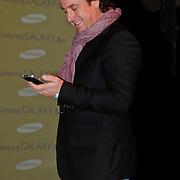 NLD/Amsterdam/20110129 - Presentatie Samsung Galaxy Ace, Marco Borsato telefonerend