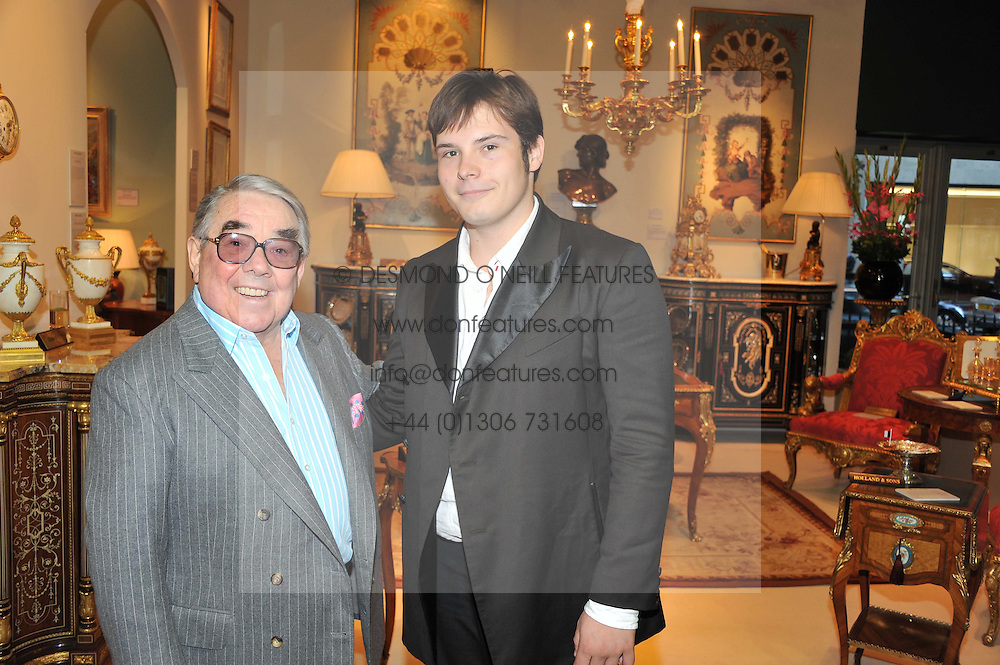 Left to right, RONNIE CORBETT and his grandson TOM CORBETT at a preview evening of the annual London LAPADA (The Association of Art & Antiques Dealers) antiques Fair held in Berkeley Square, London on 18th September 2012.