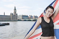 Beautiful Asian girl standing in front of Big Ben and Houses of Parliament