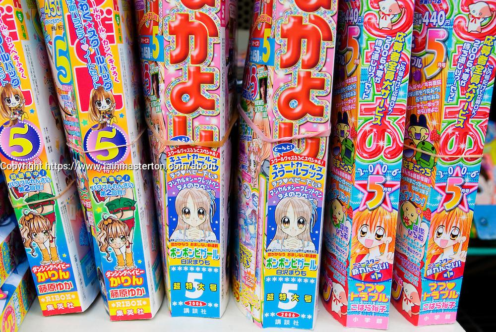 Row of popular Manga comic books in a bookshop in Japan