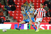 Tom Ince for Stoke City and 22 Luke Waterfall for Shrewsbury Town during the The FA Cup 3rd round replay match between Stoke City and Shrewsbury Town at the Bet365 Stadium, Stoke-on-Trent, England on 15 January 2019.