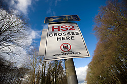 © Licensed to London News Pictures. 27/01/2012. Little Missenden, UK. An anti HS2 (High Speed Rail 2) sign showing the planned route of HS2 rail outside the village of Little Missenden, Buckinghamshire. Scheduled to be completed by 2033, the new Rail system will have huge effects on the chocolate box English village. Photo credit : Ben Cawthra/LNP