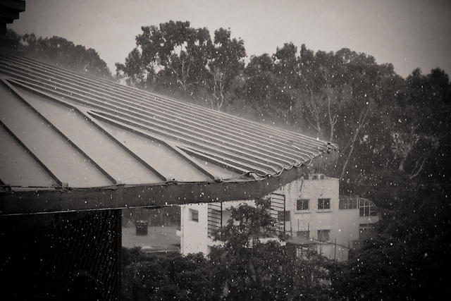 Heavy rain falling during monsoon season, falling on the roof of the Leela Palace in Bangalore, India.