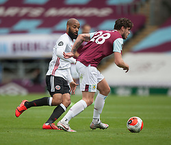 David McGoldrick of Sheffield United (L) and Kevin Long of Burnley in action - Mandatory by-line: Jack Phillips/JMP - 05/07/2020 - FOOTBALL - Turf Moor - Burnley, England - Burnley v Sheffield United - English Premier League