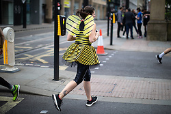 © Licensed to London News Pictures . 19/05/2019. Manchester, UK. A woman wearing a bee costume runs towards the start of the race . The Great Manchester Run takes place in Manchester City Centre , starting at Portland Street . Photo credit : Joel Goodman/LNP