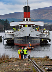 The last paddle steamship built in Britain, the Maid of the Loch, which has been moored derelict on Loch Lomond in the Trossachs National Park, is pulled out of the water for only the second time in 40 years for refurbishment.<br /> <br /> © Dave Johnston / EEm