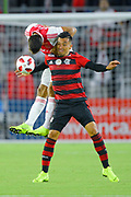 Ajax defender Lisandro Magallan (16) and Flamengo midfielder Fernando Uribe (20) go airborne for a ball during a Florida Cup match aat Orlando City Stadium on Jan. 10, 2019 in Orlando, Florida. <br /> <br /> ©2019 Scott A. Miller