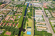 Nederland, Noord-Holland, Amsterdam, 14-06-2012; Overzicht Slotervaart met Gerbrandypark en Burgemeester Van Tienhovengracht, rechts Burgemeester De Vlugtlaan. Op het tweede plan Geuzenveld...De wijken zijn onderdeel van de Westelijke Tuinsteden, gerealiseerd op basis van het Algemeen Uitbreidingsplan voor Amsterdam (AUP, 1935). Voorbeeld van het Nieuwe Bouwen, open bebouwing in stroken, langwerpige bouwblokken afgewisseld met groenstroken. . . .Overview residential district Slotervaart, one of the western garden cities of Amsterdam-west..  Constructed on the basis of the General Extension Plan for Amsterdam (AUP, 1935). Example of the New Building (het Nieuwe Bouwen), detached in strips, oblong housing blocks alternated with green areas, built in fifties and sixties of the 20th century..luchtfoto (toeslag), aerial photo (additional fee required).foto/photo Siebe Swart