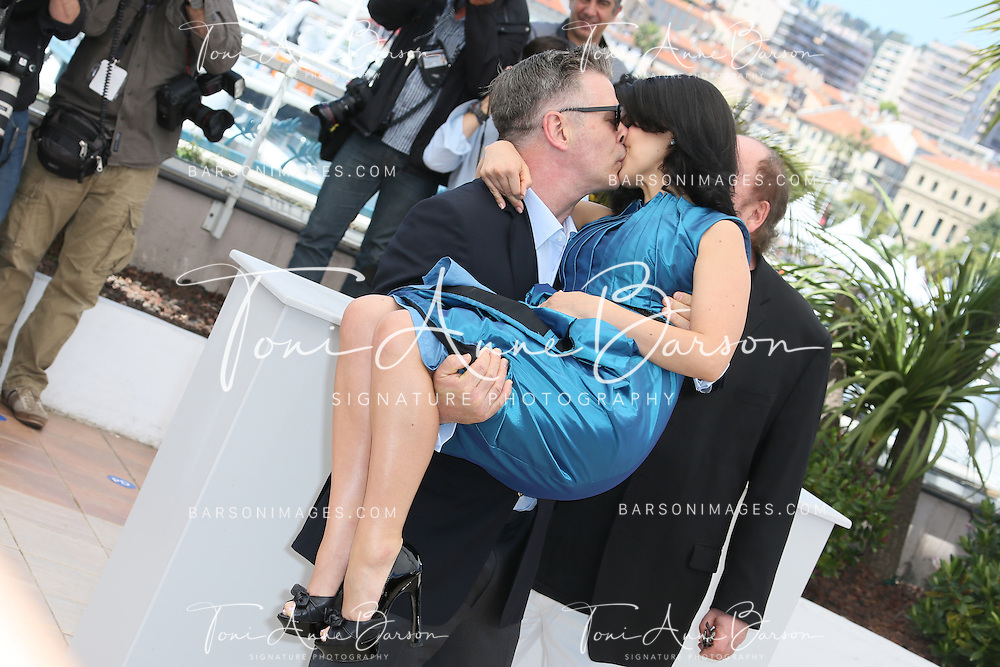 CANNES, FRANCE - MAY 21:  Alec Baldwin and Hilaria Baldwin attend the photocall for 'Seduced and Abandoned' during The 66th Annual Cannes Film Festival at Palais des Festivals on May 21, 2013 in Cannes, France.  (Photo by Tony Barson/FilmMagic)