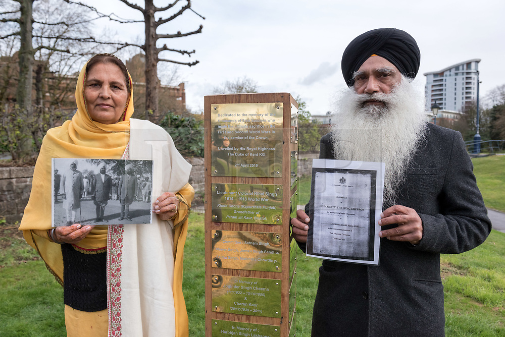 © Licensed to London News Pictures. 02/04/2019. Bristol, UK. The Bristol Sikh War Memorial and Remembrance Garden at the official opening in Bristol's Castle Park. BIBI PARMJIT KAUR and her husband JAS BIR SINGH, with pictures of Bibi's great-grandfather Lieutenant Colonel Nihal Singh who fought in the First World War and has a plaque on the memorial. The Bristol Sikh War Memorial and Remembrance Garden at the official opening in Bristol's Castle Park, to honour an estimated 83,000 Sikh soldiers who lost their lives in the First and Second World Wars, and more than 100,000 who were seriously wounded. The unveiling was performed by HRH The Duke of Kent, KG. The garden is close to the ruins of St Peter's Church and has been organised by the Bristol Sikh War Memorial Committee to be a peaceful way to remember the Sikh lives lost during the two conflicts. The idea was formed four years ago when Dilawer Singh Potiwal, the project leader of the committee, was attending a commemorative event with long-serving former Labour councillor Ron Stone, who died in 2015, and they had an idea that the Bristol Sikh community do something for their ancestors. All except the architects involved with the war memorial did so as volunteers. Photo credit: Simon Chapman/LNP
