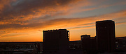 Idaho. Boise. Sunset clouds with downtown buildings in silhouette.