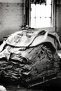 In December 1995, a final order of burlap bags, marking more than a century of production at Werthan Packaging, rests  on the factory's work floor. Untitled