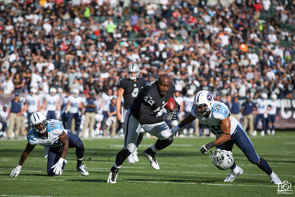 Oakland Raiders running back Jamize Olawale (49) carries the ball against the Tennessee Titans at Oakland Coliseum in Oakland, Calif., on August 26, 2016. (Stan Olszewski/Special to S.F. Examiner)