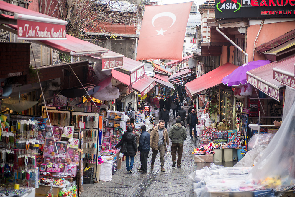 View down narrow street lined with shops selling various goods, Turkey