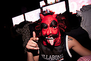 CRAZY CLUBBER IN DEVIL MASK WITH TONGUE HANG OUT