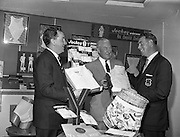 "10/10/1959<br /> 10/10/1959<br /> 10 October 1959<br /> Christy O'Connor ""Senior' (right), well known professional golfer selecting shirts at Dublin Shirt and Collar Co., Sycamore Street, Dublin. O'Connor is waring his 1957 Ryder Cup Jacket, in which competition he played an important part in securing the British team's win over the United States."