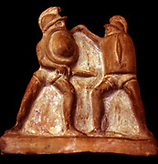 Terracotta figureines showing a Thracian fighting a Hoplomachus. Roman, 1st-2nd Century AD. Both these types of gladiators had distinctively small shields. The Thracian's (right) was rectangular, that of the Hoplomachus was round The Hoplomachus could also be armed with a spear