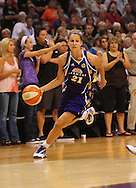 June 4, 2010; Phoenix, AZ, USA; Los Angeles Sparks guard Tisha Penicheiro drives the ball against the Phoenix Mercury during the first half at US Airways Center.  The Mercury defeated the Sparks 90-89.  Mandatory Credit: Jennifer Stewart-US PRESSWIRE
