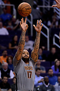 Feb 13, 2017; Phoenix, AZ, USA; Phoenix Suns forward P.J. Tucker (17) shoots the ball against the New Orleans Pelicans in the first half of the NBA game at Talking Stick Resort Arena. Mandatory Credit: Jennifer Stewart-USA TODAY Sports