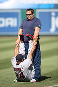 ANAHEIM, CA - AUGUST 21:  Michael Bourn #24 of the Cleveland Indians stretches with a trainer before the game against the Los Angeles Angels of Anaheim on Wednesday, August 21, 2013 at Angel Stadium in Anaheim, California. The Indians won the game 3-1. (Photo by Paul Spinelli/MLB Photos via Getty Images) *** Local Caption *** Michael Bourn