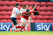 Bolton Wanderers forward Conor Wilkinson (35) fouling Charlton Athletic defender Jason Pearce (16) during the EFL Sky Bet Championship match between Charlton Athletic and Bolton Wanderers at The Valley, London, England on 27 August 2016. Photo by Matthew Redman.