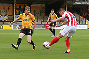 Brad Halliday blocks a Kevin Dawson cross  during the EFL Sky Bet League 2 match between Cambridge United and Cheltenham Town at the Cambs Glass Stadium, Cambridge, England on 25 August 2018.