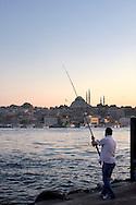 Fisherman at Istanbul's Galata bridge
