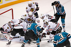 May 18, 2010; San Jose, CA, USA; San Jose Sharks players and Chicago Blackhawks players fight for the loose puck during the first period of game two of the western conference finals of the 2010 Stanley Cup Playoffs at HP Pavilion.  The Blackhawks defeated the Sharks 4-2. Mandatory Credit: Jason O. Watson / US PRESSWIRE