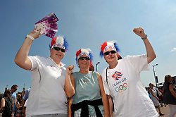 © Licensed to London News Pictures. 25/07/2012. Cardiff, Wales, UK.  Spectators arrive for the first event of the 2012 Olympics, the womens football match between Great Britain and New Zealand at the Millennium Stadium in Cardiff. 25 July 2012..Photo credit : Simon Chapman/LNP