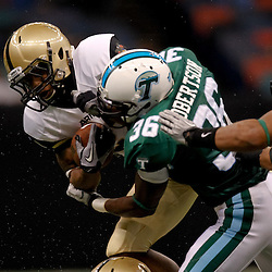 October 9, 2010; New Orleans, LA, USA; Army Black Knights running back Malcolm Brown (23) is hit by Tulane Green Wave linebacker Dominique Robertson (36) on a run during the first half at the Louisiana Superdome.  Mandatory Credit: Derick E. Hingle