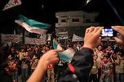 A typically night demonstration in Sarmin, Syria. The village of Sarmin near Idlib city came under heavy shelling in march. Many houses were destroyed and dozens of people died when helicopters fired into and the 76. Brigade raided the big village.