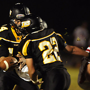Topsail's Nick Altilio hands off to Wayland Batson.
