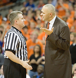 Virginia head coach Dave Leitao argues with a referee after J.R. Reynolds went to the court, suffering from leg cramps -- the officials allowed play to continue, despite the 5-4 man advantage.  The University of Virginia Cavaliers beat the #8 ranked Duke University Blue Devils 68-66 in overtime at the John Paul Jones Arena in Charlottesville, VA on February 1, 2007...