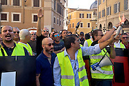 Roma 10 Settembre 2015<br />  I tassisti romani protestano davanti a piazza Montecitorio per chiedere la cancellazione degli emendamenti presentati da alcuni deputati  a favore della multinazionale americana Uber. I tassisti denunciano  che il vice Presidente di Uber e il nuovo manager per l'Italia, sono stati avvistati in mattinata a palazzo Chigi sede del Governo Renzi e nella  sede del Partito Democratico.<br /> Rome September 10, 2015<br /> The Roman taxi drivers are protesting in front of Piazza Montecitorio to ask the cancellation of the amendments tabled by Members in favor of the American multinational Uber. Taxi drivers denounce that the Vice President of Uber and the new manager for Italy, were spotted  at Palazzo Chigi, the seat of the government Renzi and  in the headquarters of the Democratic Party.