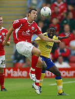 Photo: Paul Thomas.<br /> Barnsley v Southampton. Coca Cola Championship. 19/08/2006.<br /> <br /> Antony Kay of Barnsley wins the ball ahead of Nathan Dyer (R).