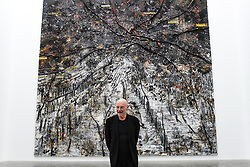 "© Licensed to London News Pictures. 14/11/2019. LONDON, UK. Anselm Kiefer next to his work ""Ramanujan Summation"" 1/12, 2018-2019, at the preview of a new exhibition called ""Superstrings, Runes, The Norns, Gordian Knot"" by Anselm Kiefer.  The works include large scale paintings and installations that draw on the scientific concept of string theory and are on display at the White Cube Gallery in Bermondsey 15 November to 26 January 2020.  Photo credit: Stephen Chung/LNP"