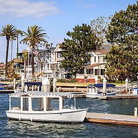 Photo of Orange County California waterfront luxury homes with Duffy Boats in Newport Beach California. Newport Beach is an affluent beach community along the Pacific Ocean in Southern California. Photo is high resolution and was taken in 2012.