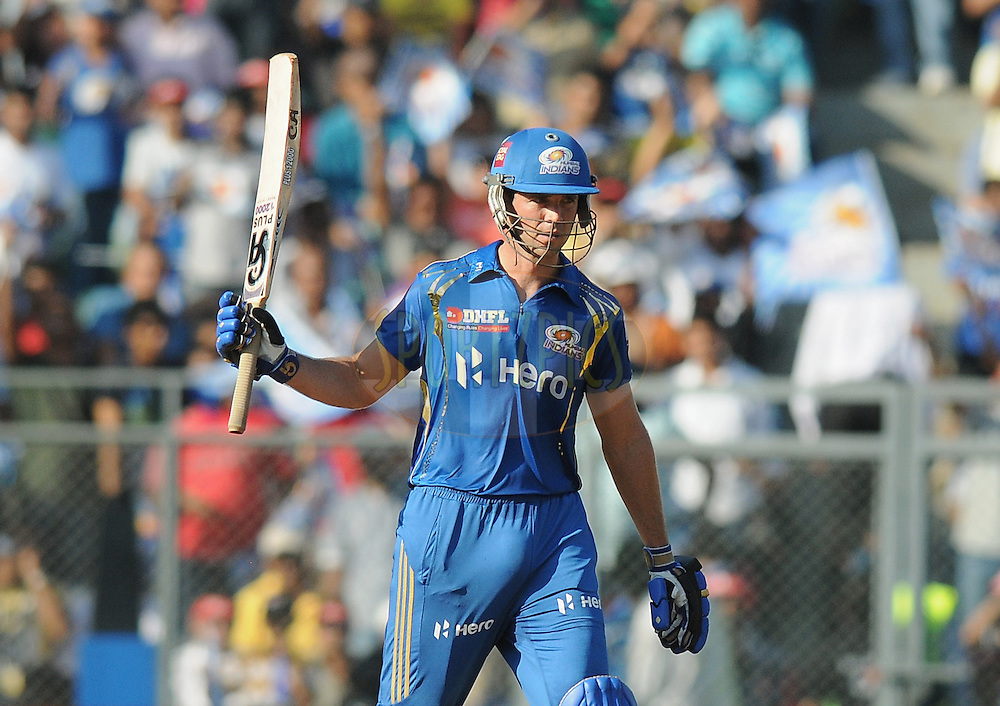 James Franklin of Mumbai Indians raises his bat after scoring a half century during match 28 of the Indian Premier League ( IPL) 2012  between The Mumbai Indians and the Kings X1 Punjab held at the Wankhede Stadium in Mumbai on the 22nd April 2012..Photo by Pal Pillai/IPL/SPORTZPICS..