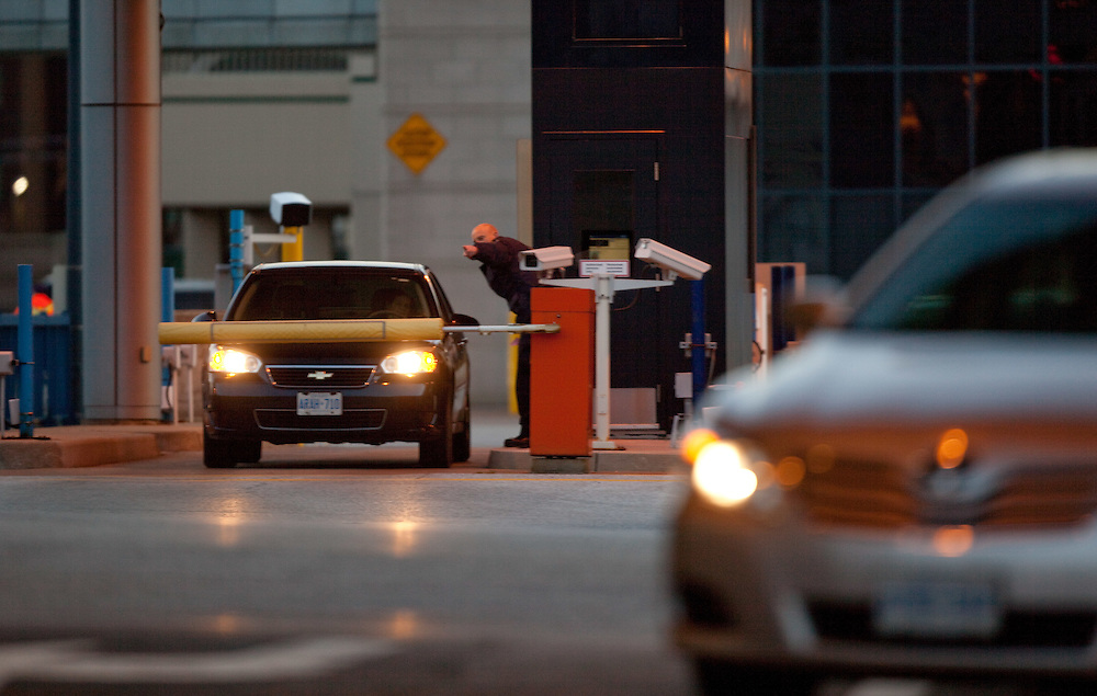 Windsor, Ontario ---11-12-07--- A Canada Border Services Agent directs a car for further inspection at the Detroit&ndash;Windsor Tunnel border crossing December 7, 2011.<br /> GEOFF ROBINS The Globe and Mail