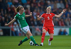 NEWPORT, WALES - Tuesday, September 3, 2019: Northern Ireland's Lauren Wade (L) and Wales' Rhiannon Roberts during the UEFA Women Euro 2021 Qualifying Group C match between Wales and Northern Ireland at Rodney Parade. (Pic by David Rawcliffe/Propaganda)