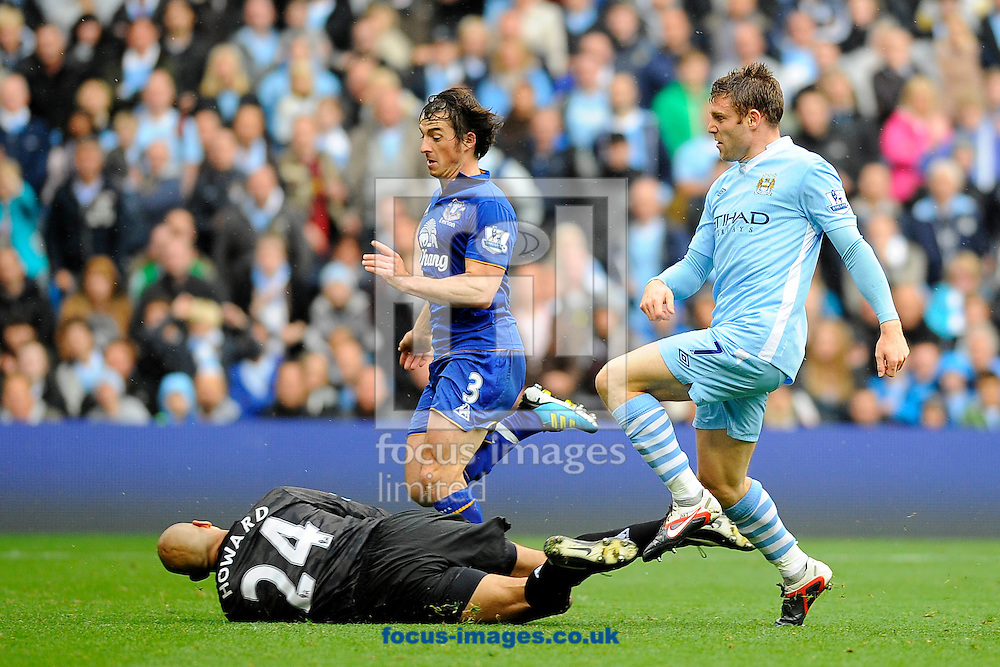 Picture by Ste Jones/Focus Images Ltd.  07706 592282.24/9/11.James Milner of Manchester City scores his side's second goal during the Barclays Premier League match at Etihad Stadium, Manchester.