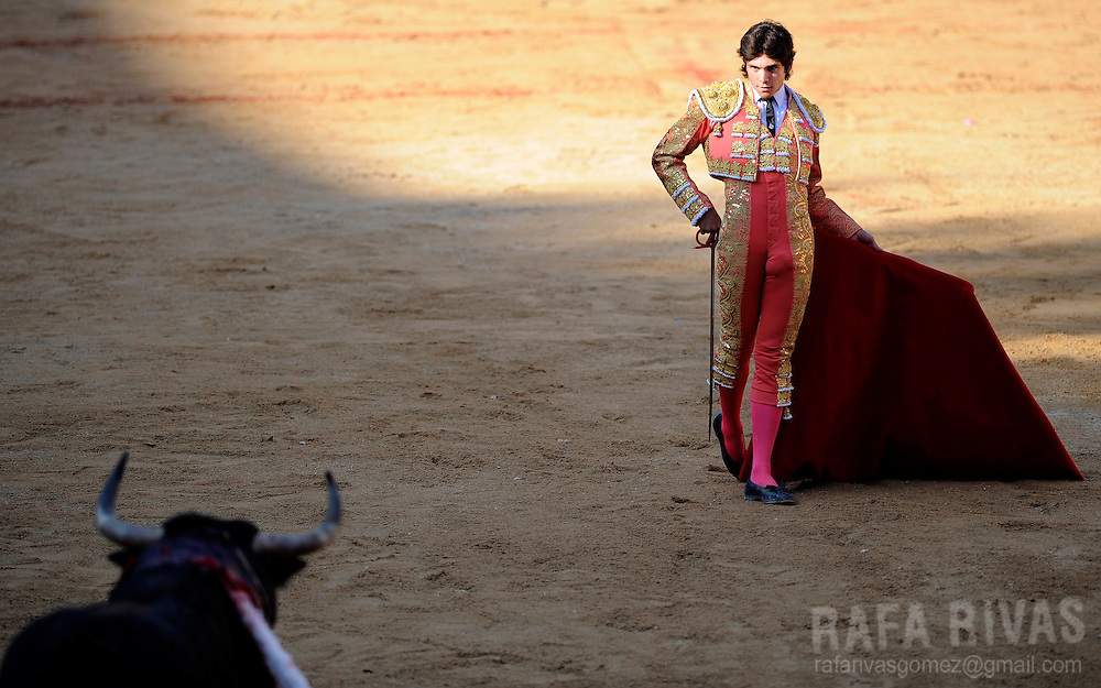 French bullfighter Sebastian Castella looks at his Fuente Ymbro fighting bull, on July 9, 2008, in the Spanish city of Pamplona, during the thirth corrida of the San Fermin festivities.