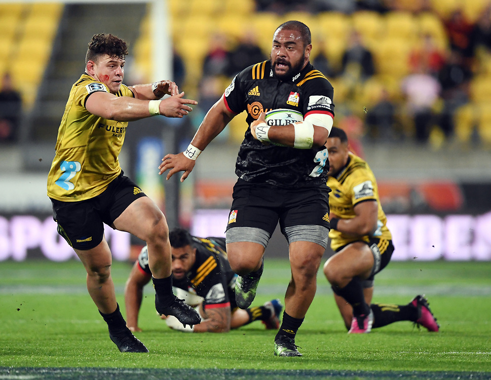 Chiefs Karl Tu'inukuafe, right, runs pass Hurricanes Ricky Riccitelli in the Super Rugby match at Westpac Stadium, Napier, New Zealand, Friday, April 13, 2018. Credit:SNPA / Ross Setford