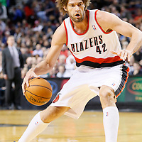 02 December 2013: Portland Trail Blazers center Robin Lopez (42) dribbles during the Portland Trail Blazers 106-102 victory over the Indiana Pacers at the Moda Center, Portland, Oregon, USA.